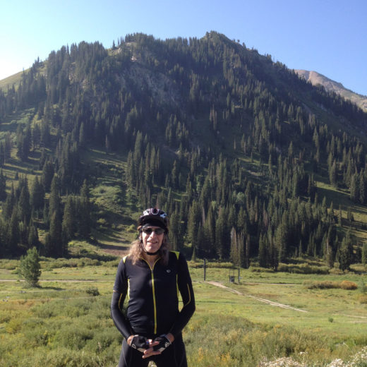 Hap Farber in front of a verdant mountain in summer