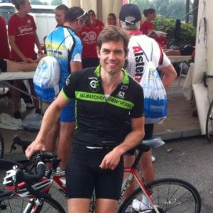 Axel Schauf smiling with bike