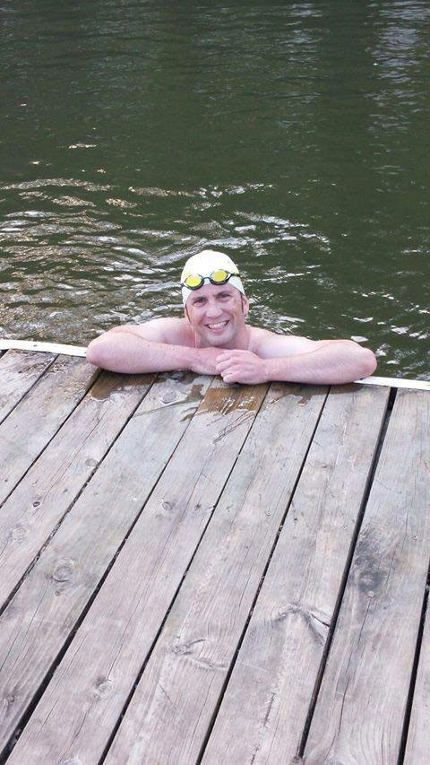 Timothy Bachman in a lake after a swim