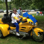 Merle Reeseman on yellow motorbike
