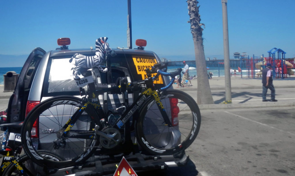 Team PHenomenal Hope bike on a rack in Oceanside California