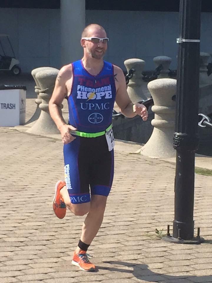 Dustin Wehler running in his Team PH race kit