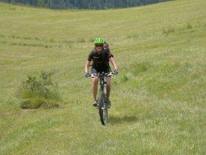 Kristen-Engle-biking-grassy-field