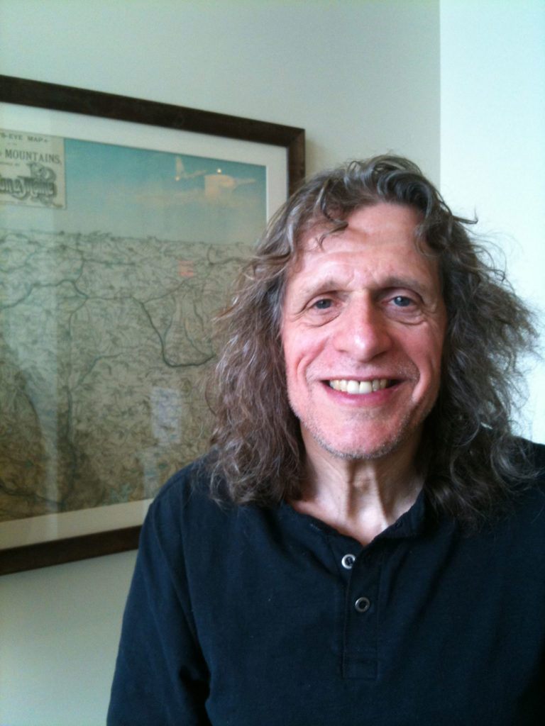 Hap Farber in front of a map in an office
