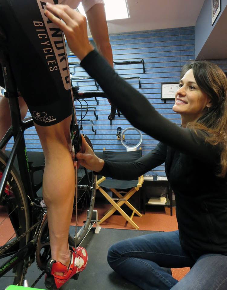 Thea Kent measuring a cyclist for a bike fitting