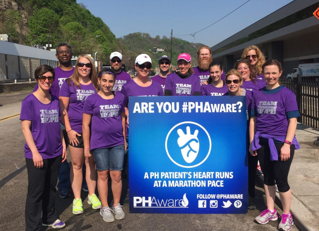 A team of volunteers pause for a group photo at the O'Nala First Aid Station during the 2015 Pittsburgh Marathon