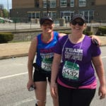 A pair of Team PHenomenal Hope runners catch up with one another for a duo photo during the 2015 Pittsburgh Marathon