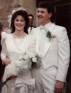 Beth and Dan Kolopajlo smiling at their wedding