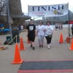 Janice Janus crossing the finish line
