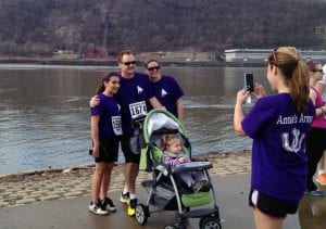 Anna Lindner with her folks on the north shore of Pittsburgh during the annual PH5k race