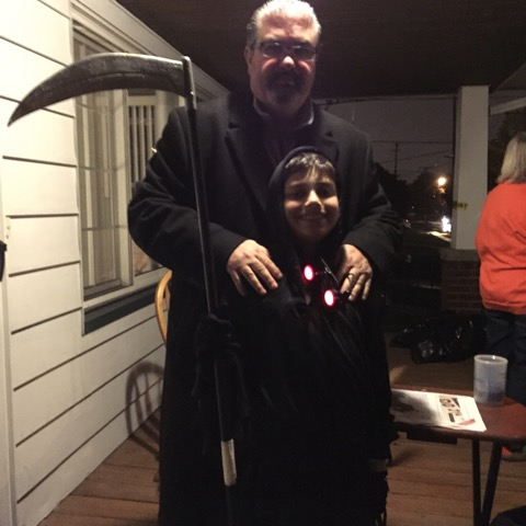 David Grady posing with his son at Halloween