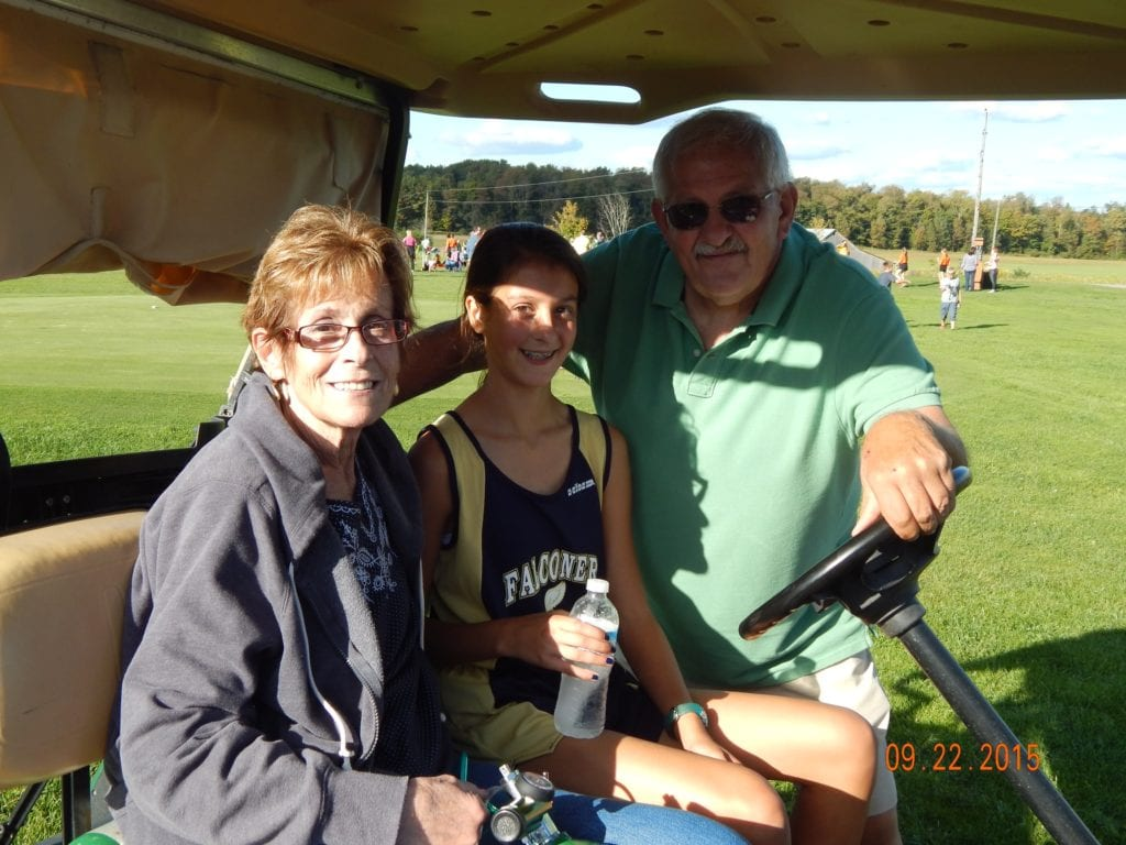 Cynthia pictured with her husband, Denny at her granddaughter's cross country meet. The home meets are held at a golf course and her son-in-law arranged for her to use a golf cart so she could follow the race. ( She always takes her oxygen off for photos.)