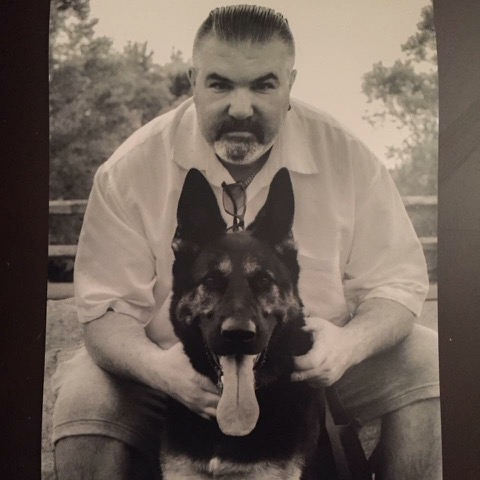 David Grady posing with his canine