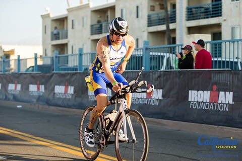 Jamie racing his bike in Ironman 70.3 California