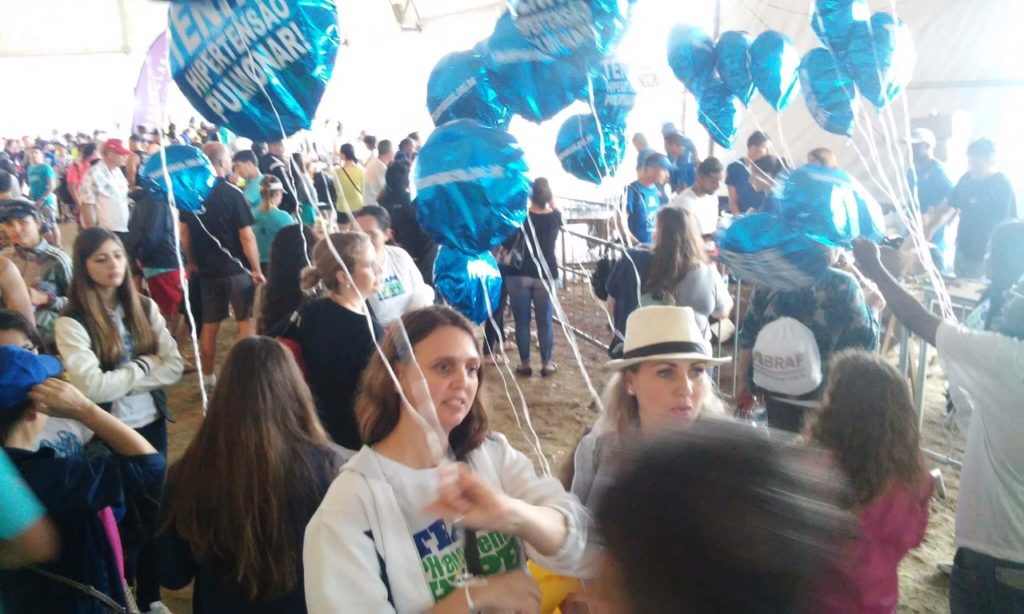 Patients and supporters holding balloons, waiting for the grand finish