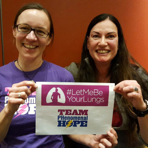 Katrin Hetebruegge and Monika Kischel holding a LetMeBeYourLungs sign