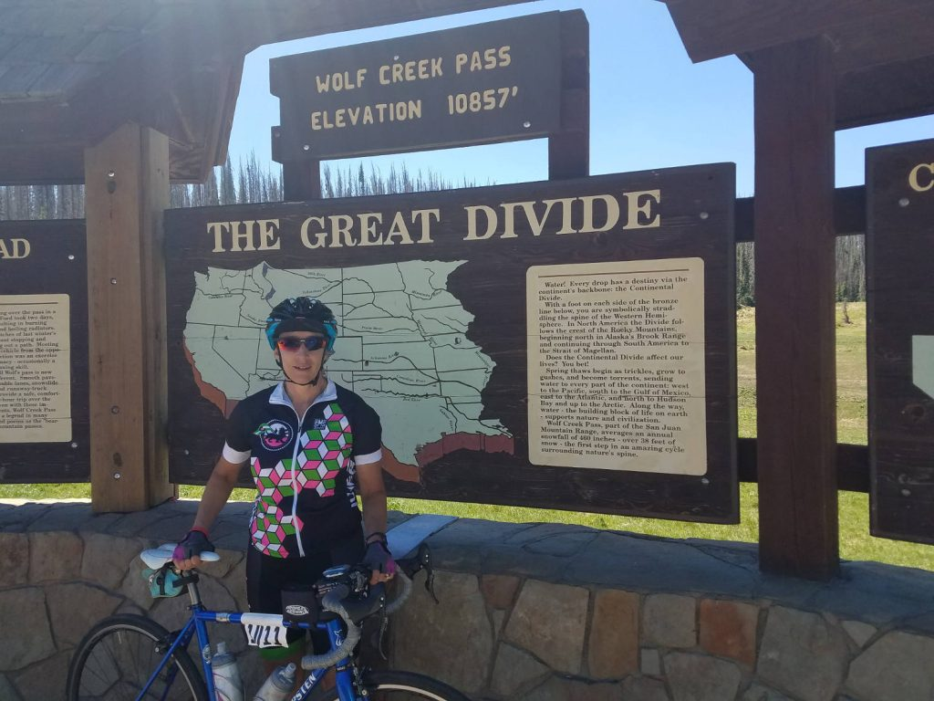 Gretchen Frey at The Great Divide with her bicycle in 2017