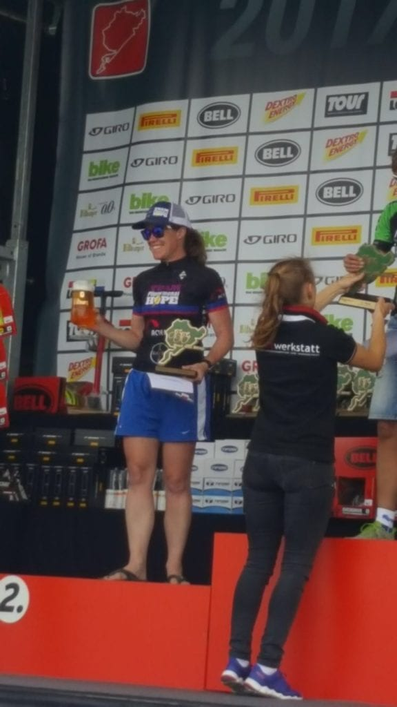 Patty George at the winners podium of the 2017 Rad am Ring in Germany for second place